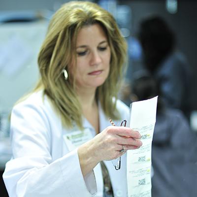 Pharmacist verifies PASS packaging