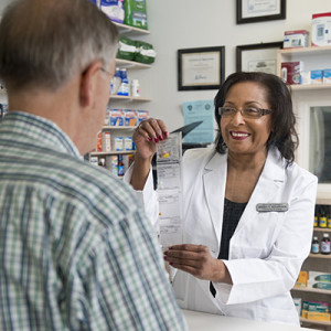 Pharmacist displays PASS adherence packaging