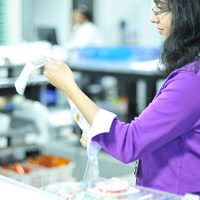 Pharmacy technician inspecting PASS packaging
