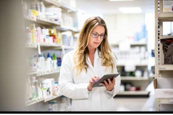 Pharmacist with touchscreen tablet