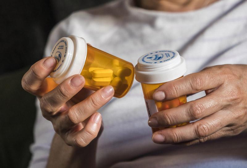 Woman examining medication vials