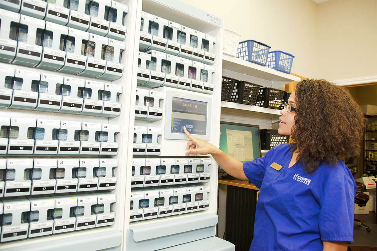 Cooper Drug technician operates the Parata PASS