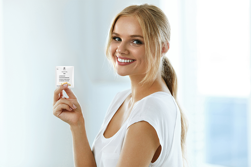 happy customer holding nutraceutical pouch