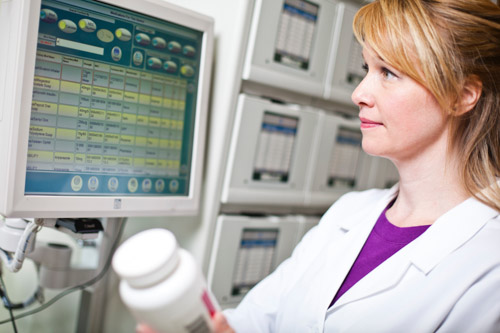 Pharmacist verifies drugs for ATP 2