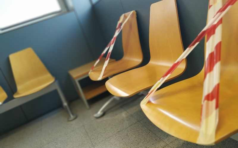 Chairs marked to enforce social distancing in a waiting area