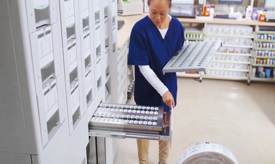 technician using special tablet tray with ATP 2 packager
